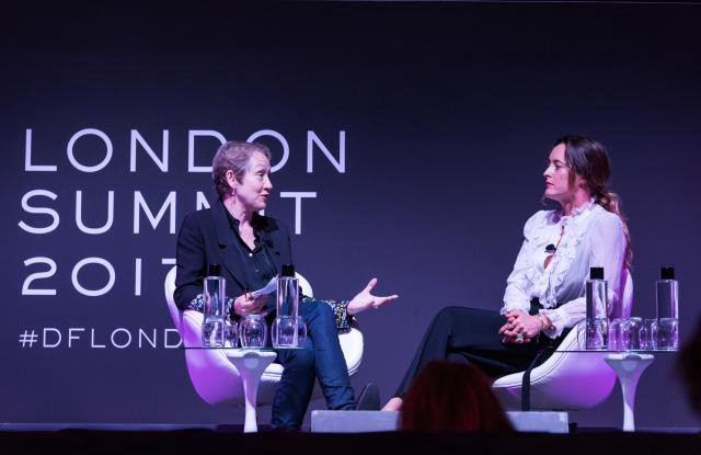 Women interviewing woman of stage