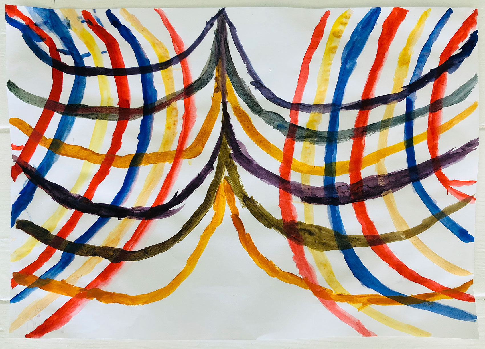 Abstract criss-cross lines in red, yellow and blue